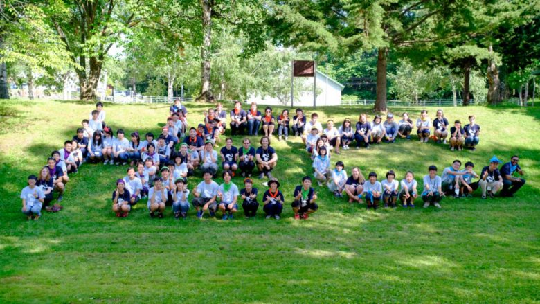 "A picture of all of the students and volunteers spelling ""HEC"""